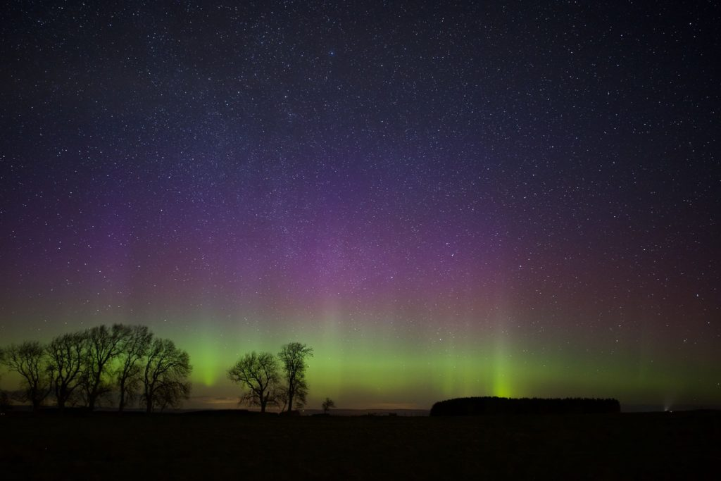 "alt=""Northumberland's International Dark Skies Park showing the Northern Lights"""