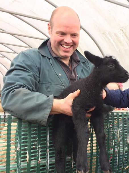 """alt=""""farmer john happy at lambing time"""""""