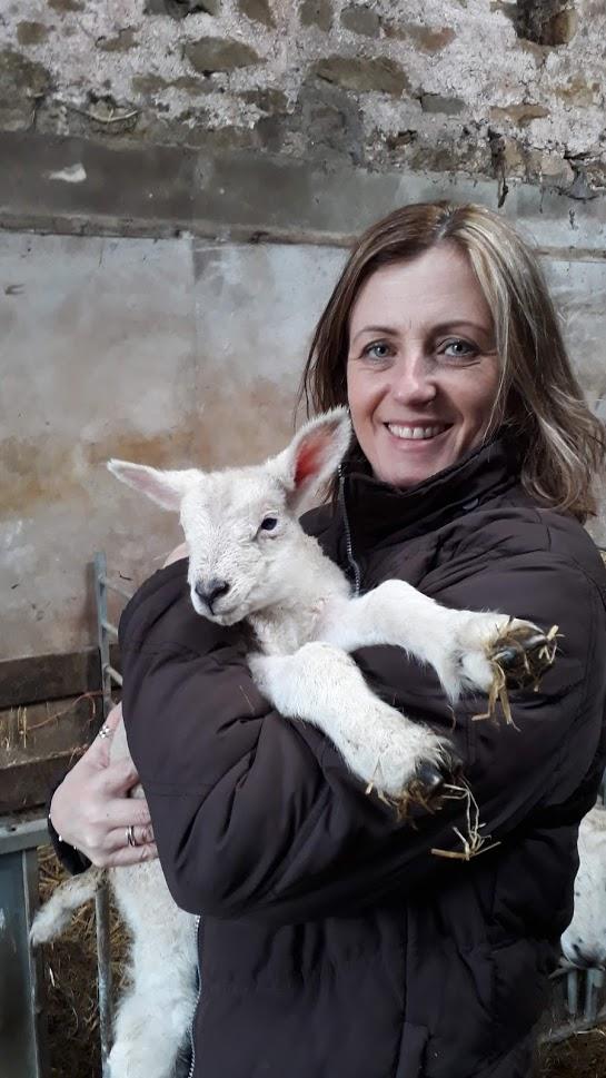 "alt=""holding a lamb"""