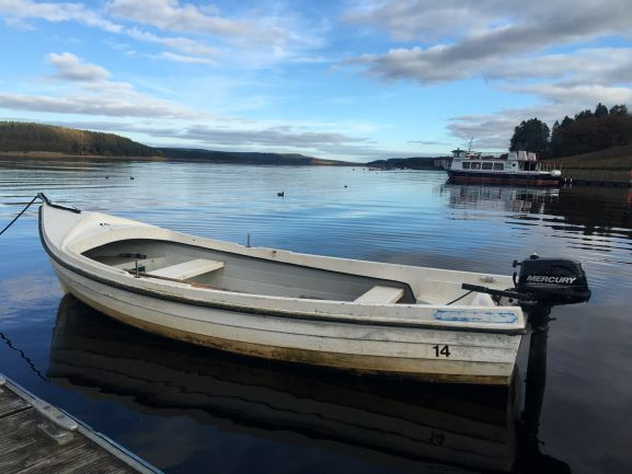 "alt=""kielder water with boat on it"""